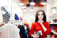 Elegant Woman Keeping a Secret in Fashion Store Royalty Free Stock Image