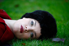 Elegant woman laying on grass Stock Images
