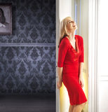 Elegant woman leaning against the door Royalty Free Stock Photography