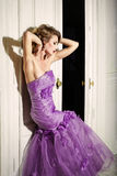 Elegant woman in a lilac dress. Elegant woman in a lilac dress standing in profile in the door Stock Photos