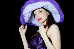 Elegant woman in a lilac hat Stock Image
