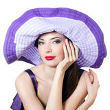 Elegant woman in a lilac hat Royalty Free Stock Images