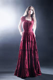 Elegant woman in long dress Fashion model Royalty Free Stock Images
