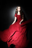 Elegant woman in long dress Red fashion Stock Images