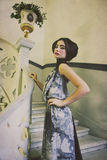 Elegant woman in long dress on vintage stairs stock images