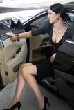 Elegant woman with long legs in car Stock Photo