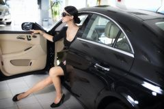 Elegant woman with long legs in car Stock Photos