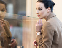 Elegant woman looking at window shop Stock Photography