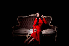 Elegant woman with make up wearing red dress Stock Photos