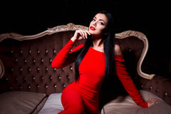 Elegant woman with make up wearing red dress Royalty Free Stock Image