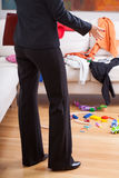 Elegant woman in messy room Royalty Free Stock Images