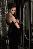 Elegant woman and mirror Royalty Free Stock Image