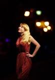 Elegant woman on night city background Stock Photo