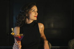 Elegant Woman In a Night Club. Drink Cocktail Stock Photo