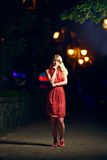 Elegant woman on night street Royalty Free Stock Photos
