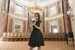 Elegant woman in old auditorium Royalty Free Stock Photography