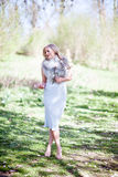 Elegant woman in park Royalty Free Stock Photography