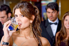 Elegant woman at a party Stock Image