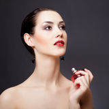 Elegant woman with perfume Royalty Free Stock Photos