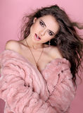 Elegant woman in pink fur coat in fashion style Stock Photos
