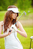 Elegant woman playing golf Royalty Free Stock Images