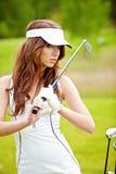Elegant woman playing golf Royalty Free Stock Images
