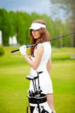 elegant woman playing golf Stock Photos