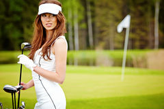 elegant woman playing golf Stock Image