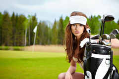 Elegant woman playing golf Stock Photos