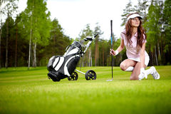 Elegant woman playing golf Royalty Free Stock Photos