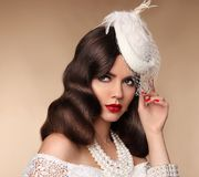 Elegant woman portrait in retro hat. Pin up girl wears in pearls Stock Images