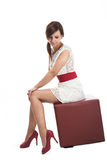 Elegant woman posing on a leather seat Royalty Free Stock Photography
