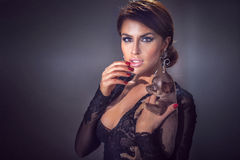 Elegant woman with puppy Royalty Free Stock Photo