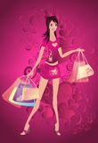 Elegant woman with purchase bags Royalty Free Stock Photography