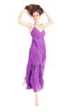 Elegant woman in a purple dress Royalty Free Stock Image
