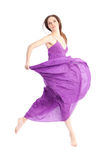 Elegant woman in a purple dress. Holding her hair Stock Image