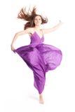Elegant woman in a purple dress Stock Image