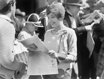 Elegant woman reading a newspaper Stock Images
