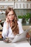 Elegant woman reading newspaper Royalty Free Stock Photo