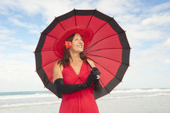 Elegant woman red dress at beach Royalty Free Stock Photo