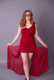 Elegant woman in a red dress. Sensual beauty lovely makeup mask mysterious art Royalty Free Stock Photos