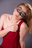 Elegant woman in a red dress. Sensual beauty lovely makeup mask mysterious art Royalty Free Stock Images