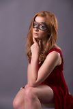 Elegant woman in a red dress. Sensual beauty lovely makeup mask mysterious art Stock Photography