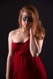 Elegant woman in a red dress. Sensual beauty lovely makeup mask mysterious art Stock Photos