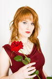 Elegant woman with red rose on valentines day. Young sexy elegant woman with red rose on valentines day. gray background Stock Photos