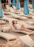 Elegant woman relaxing on beach at hotel resort Stock Photo