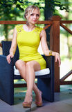 Elegant woman relaxing outdoors. Beautiful elegant woman relaxing outdoors Royalty Free Stock Photography