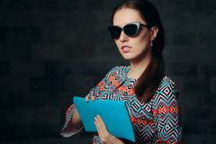 Elegant Woman with Retro Cat Eye Sunglasses and Clutch Purse stock photography