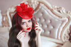 Elegant woman in retro hat with red lips and manicured nails. Br Royalty Free Stock Photo