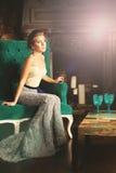 Elegant Woman in Retro Palace Interior. Background Stock Photo